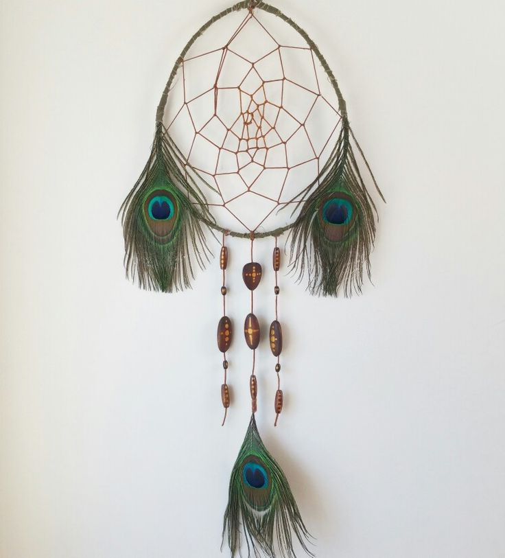A wonderful Peacock Dreamcatcher  #peacockdreamcatcher #peacock #dreamcatcher #feathers #diydreamcatcher