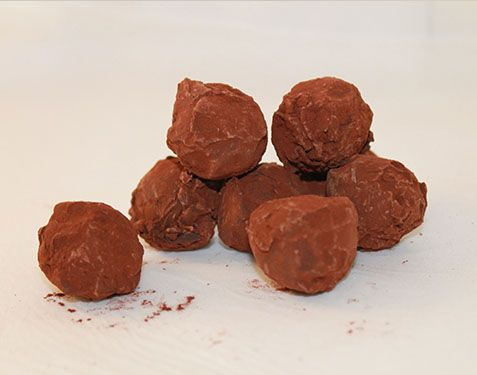Cocoa Bon Truffles  For those who prefer the darker side of life! Dark chocolate truffles coated with a thin layer of crisp chocolate and rolled in the finest quality cocoa.