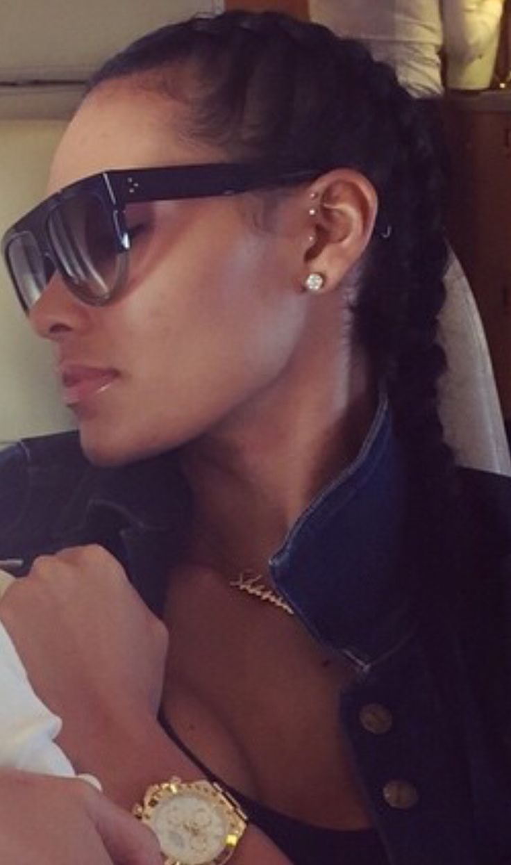 Shaniece Hairston: double forward helix and Tragus piercing