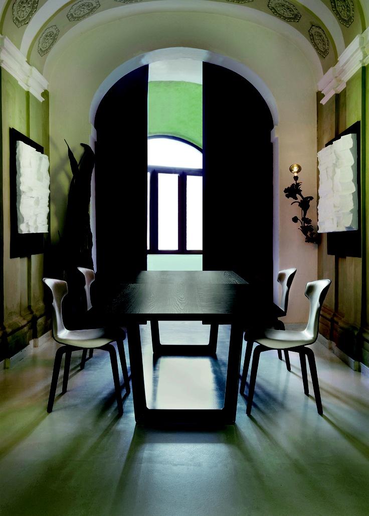"Roberto Lazzeroni has designed the ""Bolero"" table. Sleek, light lines for the living room."
