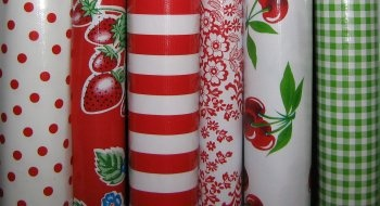 Oilcloth for the table.  Easy cleaning.  Something in red, maybe?