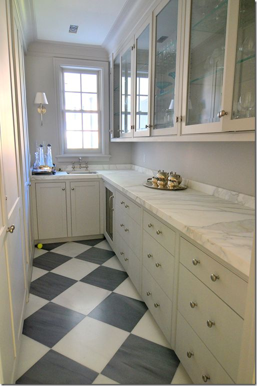 Pantry with gray checkered flooring... The Paris Ceramics gray and white marble floor is a rare pattern found in the mostly white house.