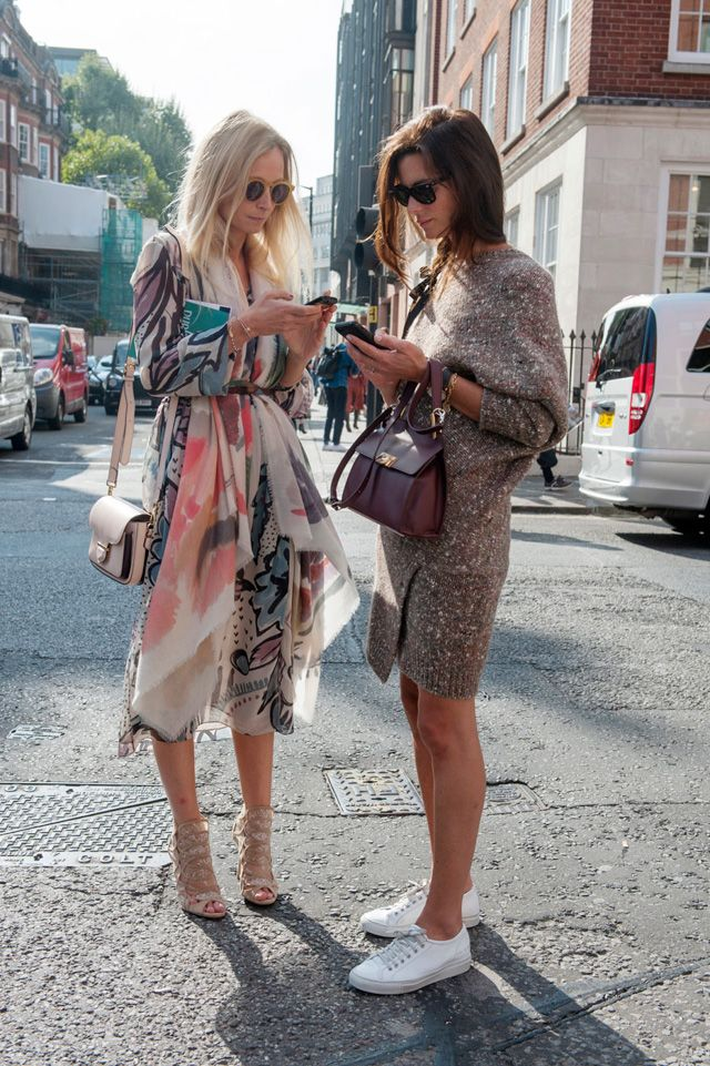 Loving the belted scarf over the floaty dress. Tres chic.