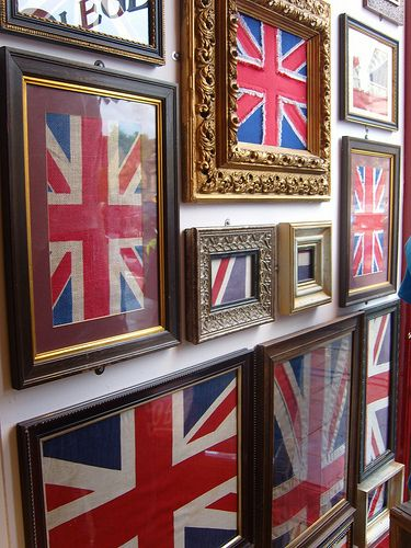 A wall of framed union jacks! Love.