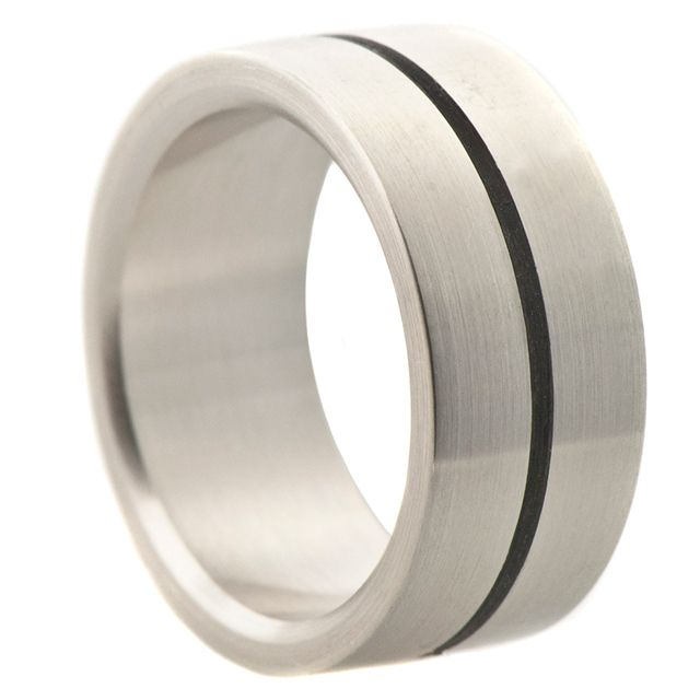 Silver and Wood Section Band   Ebony wood from Gabon (Africa) These rings are assembled with sections of wood. The sterling silver has a brushed finish.9mm width.    $370