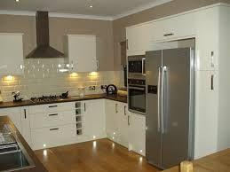 White/wood Kitchen Combo; American Fridge Freezer. Built In?