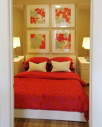 small bedroom.... art behind bed = headboard