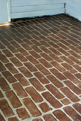 Painting faux brinks on to concrete: I bought a run-of-the mill sponge from Wal-Mart (auto department) and cut it in the shape of a brick. Then I used some red wood stain leftover from the previous owners. Are you kidding me right now??? This looks AMAZING!!!