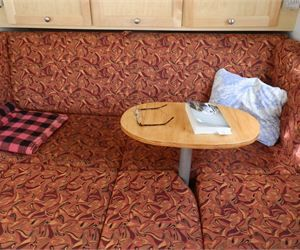 Use this idea to make a table that attaches in between the cushions of the couch