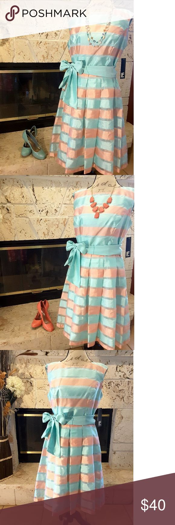 """Leslie Fay Striped Fit-and-Flare Dress Leslie Fay Striped Fit-and-Flare Dress ▪Size 12 ▪ {Bust: 20""""} ▪ {Waist: 16""""} ▪ {Shoulder to hem: 40""""} ▪Mint and peach colored dress▪ Solid mint sash included ▪Striped organza overlay ▪ Dress 100% Polyester ▪ Lining 100% Acetate ▪One belt loop torn as pictured, but can be fixed or hidden ▪Due to lighting, actual mint color resembles last picture ▪NWT Leslie Fay Dresses"""