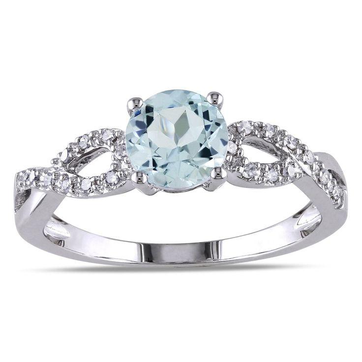 <li>Round-cut aquamarine and white diamond engagement ring</li><li>10-karat white gold jewelry</li><li><a href='http://www.overstock.com/downloads/pdf/2010_RingSizing.pdf'><span class='links'>Click here for ring sizing guide</span></a></li>
