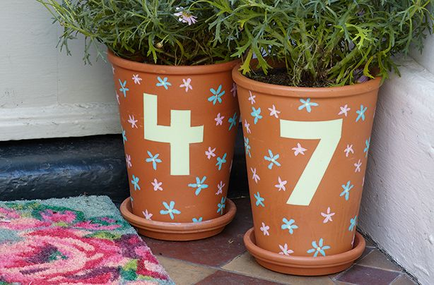This fun garden craft idea uses plant pots to make house number markers. A great kids' craft!