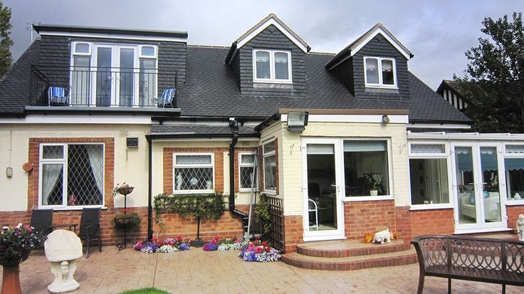Bungalow dormer loft conversion with patio doors and balcony