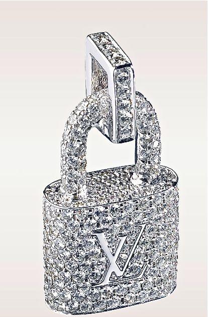 https://www.bkgjewelry.com/sapphire-ring/509-18k-white-gold-diamond-blue-sapphire-ring.html Louis Vuitton diamond padlock pendant. Beautiful