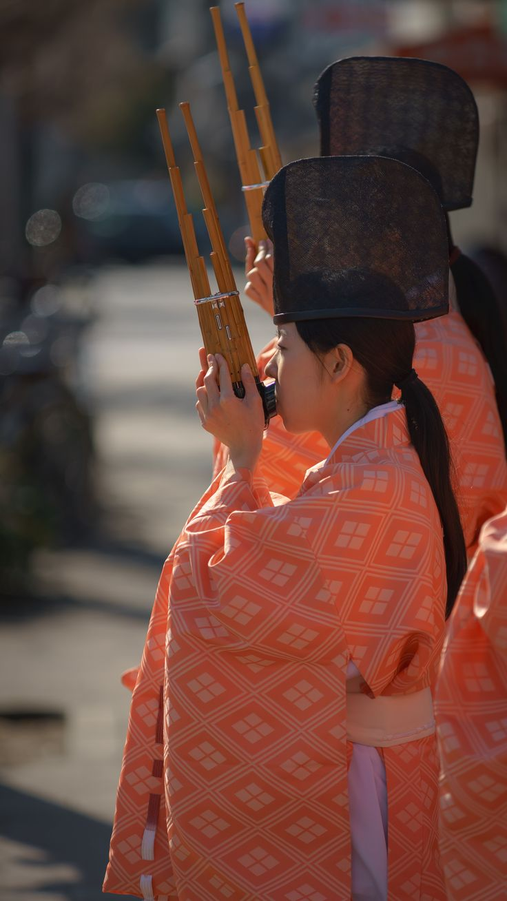 女人厄除まつり Girls play the 'Sho (Japanese traditional musical instrument)' - Women amulet Festival, Ichime-jinja shrine, Kyoto, Japan