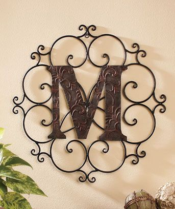 Show family pride or personalize any space with a Monogram Wall Hanging. Classically styled piece features an open scrollwork outer frame while the bold le