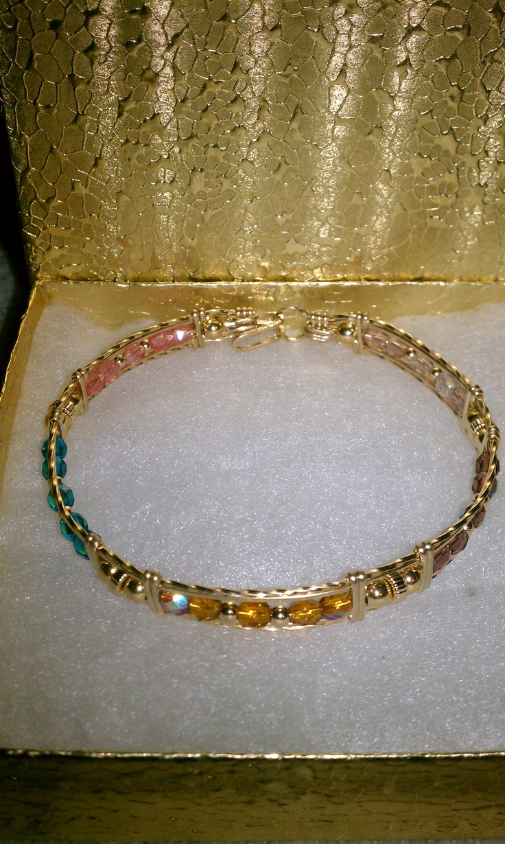 """Mother Bangle with Grandchildren birth months size 8"""" in. 14kt gf wire with Czech Republic Crystals in June, February, November, December and October birth month colors."""