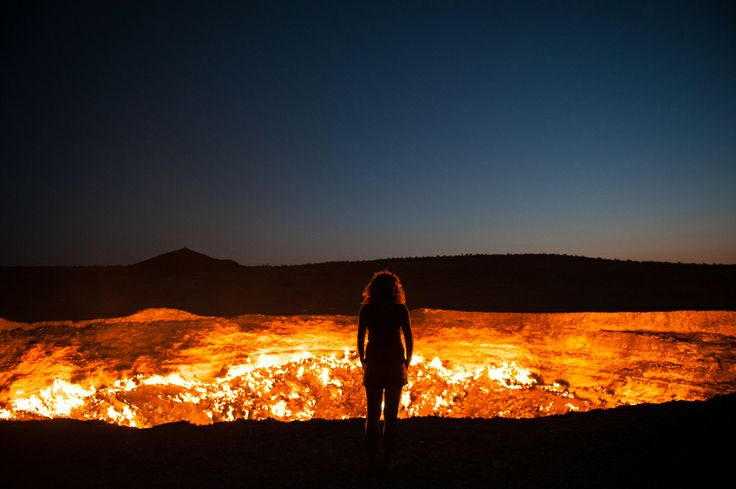 Standing at the edge of the Darvaza Crater in Turkmenistan. Known as the Door to Hell, this flaming crater has been burning for decades, fueled by the rich natural gas reserves found below the surface.   Read more at http://matadornetwork.com/notebook/13-arresting-travel-photos-from-nat-geos-2013-contest/#jtDfieh64MIVQOZs.99