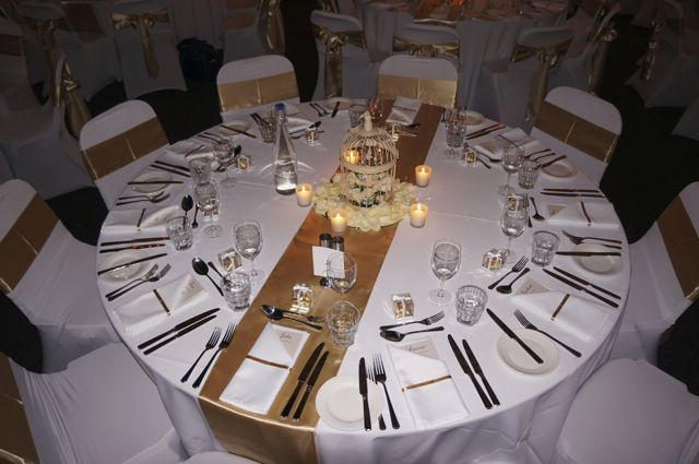 The table set and ready for the amazing food.  Sashes and birdcages and votive candles we can supply.  Contact us so that we can help with your wedding reception. http://www.tailracecentre.com.au/contact/