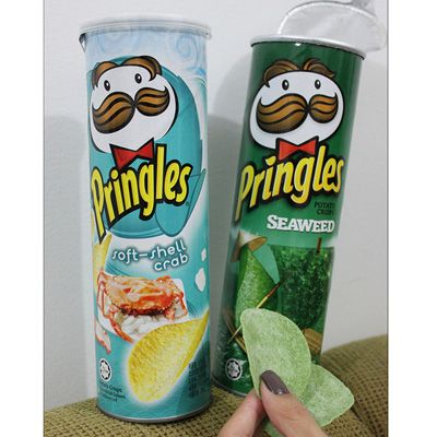 We're all familiar with Pringles brand potato chips — the popular snacks, sold in an easy-to-tote and very recognizable tube, are available the world over. But there are some distinctive Pringles flavors out there that aren't available in the U.S. Seaweed Pringles (which are appropriately bright green) and a soft-shell crab variety are only widely sold in a few select countries in Asia, like China and Thailand. If you're abroad in Asia, also look out for the company's Street Food Series of…