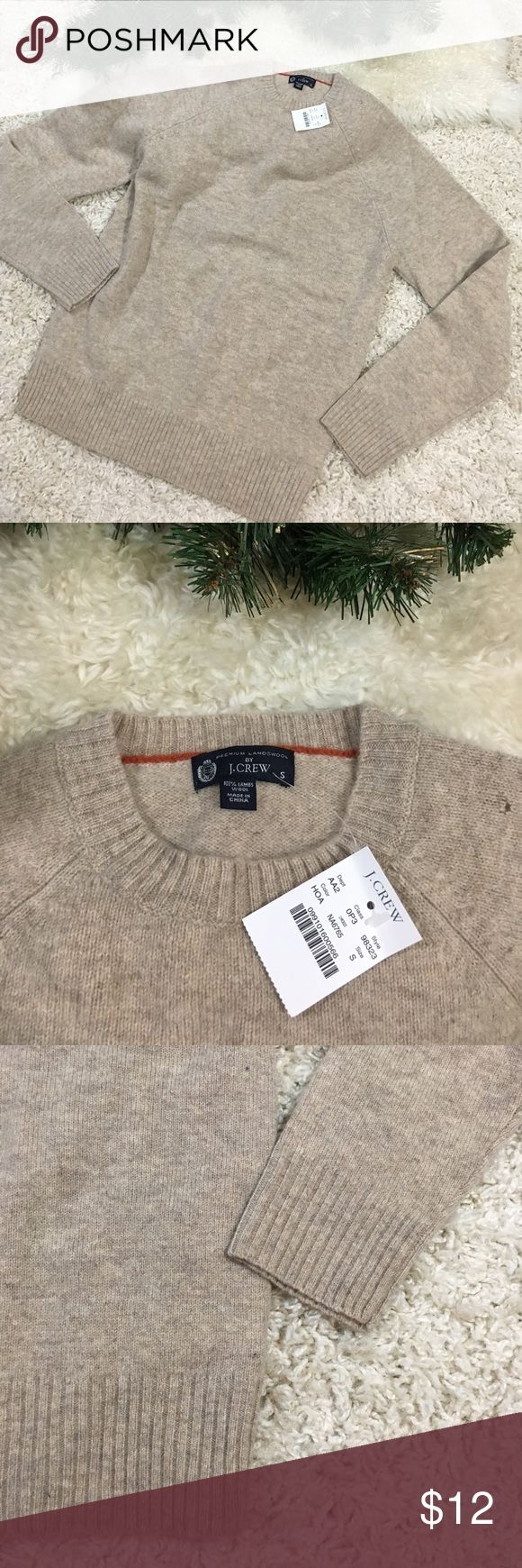 J.Crew Lambswool Sweater New! New with tags J.Crew lambswool sweater. Size small. Simply gorgeous creamy knit. This is a crew neck pullover style. I wish this beauty were in my size!  Smoke free home!  Please note this is J.Crew and not the outlet style, J.Crew factory.  PLEASE NOTE: There is a tiny hole on the shoulder. See photo. J. Crew Sweaters Crew & Scoop Necks