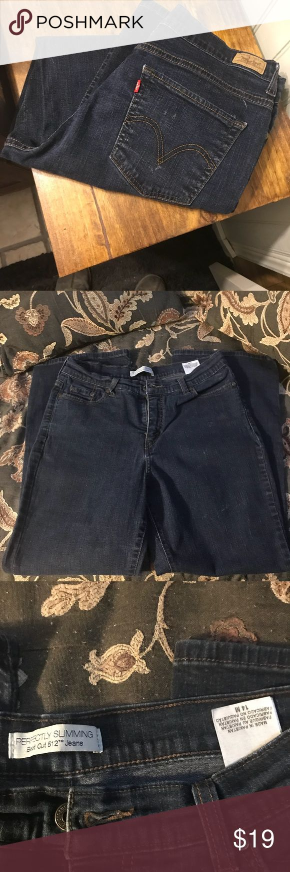 "Levi 512 size 14m. Women's jeans. Dark blue denim Levi 512 size 14m. Waist laying flat approximately 16"", but has a bunch of stretch!!! 28"" inseam. Levi's Jeans Boot Cut"