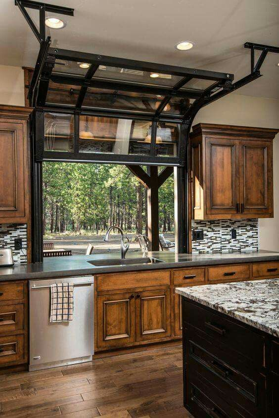 "COOLEST SPOT FOR A GARAGE!  We've seen some pretty snazzy garage doors, in some pretty unique areas, but this KITCHEN GARAGE window is awesome!  Brings new meaning to ""letting the outdoors in."""