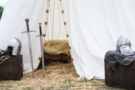 Genevieve sat outside her tent in the Royal Army's camp as she sharpened her sword. ((Open RP))