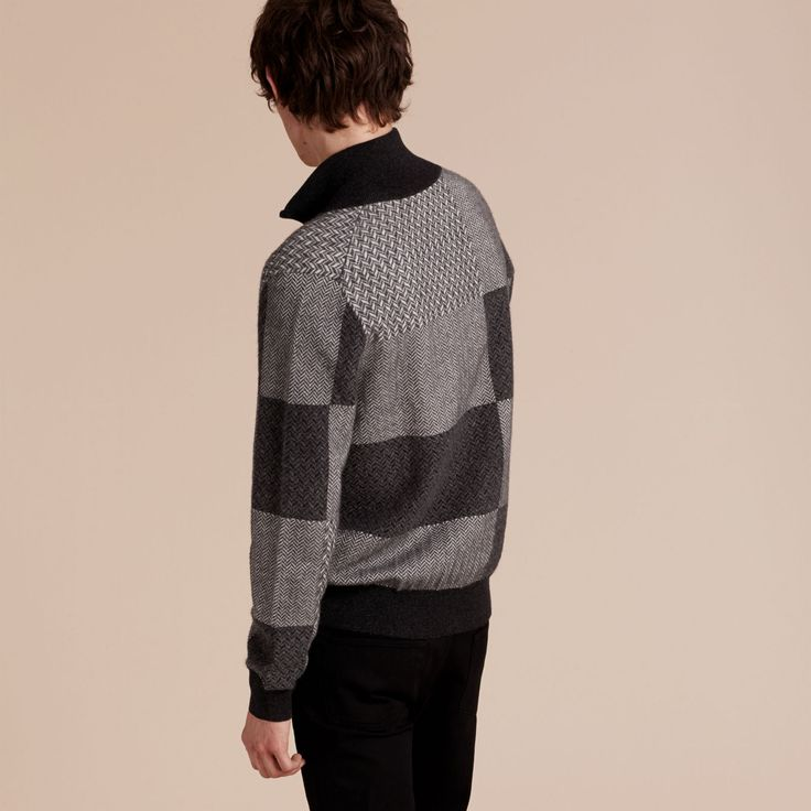 A knitted jacket made from a fluid cashmere and silk blend with a patchworked check and herringbone design. Ribbed cuffs and hem add refinement to the piece.