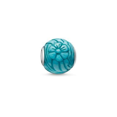 THOMAS SABO Karma Bead from the Sterling Silver Collection. sunflower - 925 Sterling silver - dyed howlite carved Size: ca. 1.1 cm The balancing howlite stone is enthralling as the Sunflower bead in its turquoise guise and with its engraved floral and polished surface. In conjunction with radiantly-summery tricolour beads its gentle sheen underlines the wonderful luminosity of the jewellery creation.