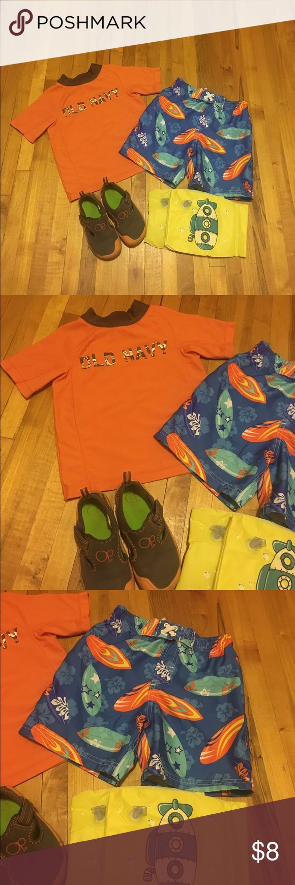 Swim set for Toddler Boy's Size 2T-3T Toddler Boy's Swim Set Size 2T-3T.Old Navy Short sleeve size 2T,Circo  size 3T have string adjustable swim trunk.Op water shoes Size 7-8M.Arms Floats.All still in good condition.No stains or any holes.Came from a smoke free and pet free home. Old Navy Matching Sets
