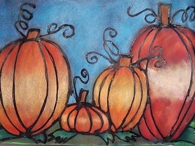 pumpkins using black glue outline, blended chalk pastels