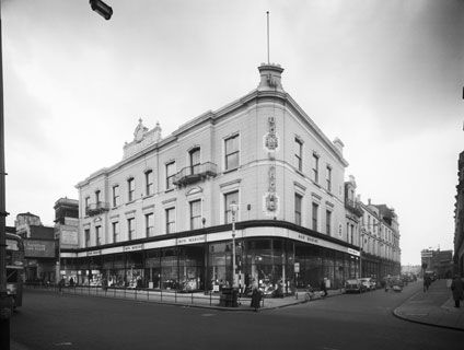 Bon Marche, Brixton was the first purpose built department store in London, erected in 1877.  © John Lewis (1958). Source English Heritage.NMR.