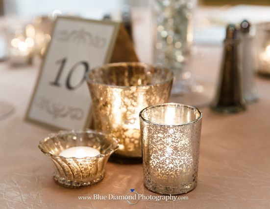 mercury glass votive holders these x 100 and white flowers everywhere #dreamdigs #modern #wedding