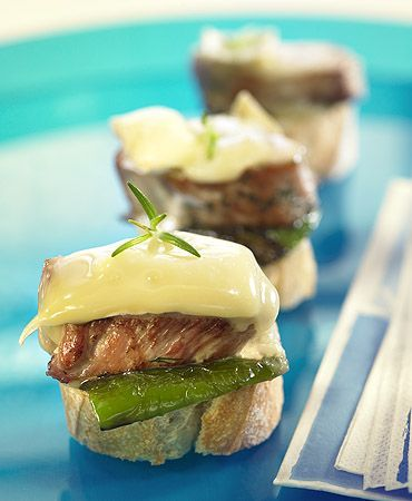 Brie, pork, and green pepper crostinis... I would trade the green pepper for poblano, and then maybe a spicy fruit chutney to bring out the tang of the brie :-)