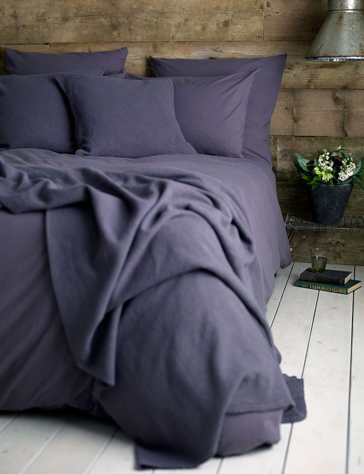 Rustic bedroom styling with our super deep purple, aubergine Washed Cotton Percale bed linen. Relaxed and washed to be super soft. Reclaimed wooden walls give this bedroom a lovely rustic country style.