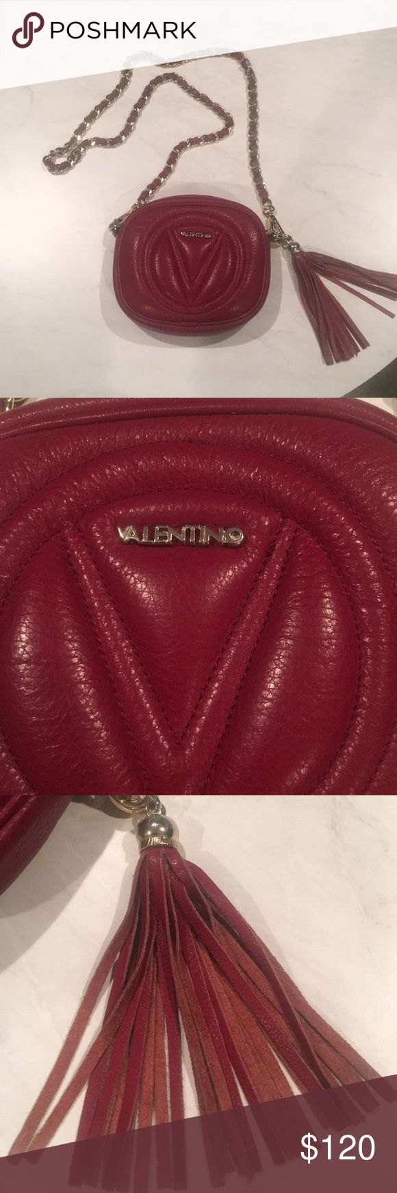 Valentino handbag Good condition( but not new  means I wore a lot) Color: burgundy 👛❤️👌 I got from outlet , that's why is low the original price ( not because fake) Valentino Bags Mini Bags