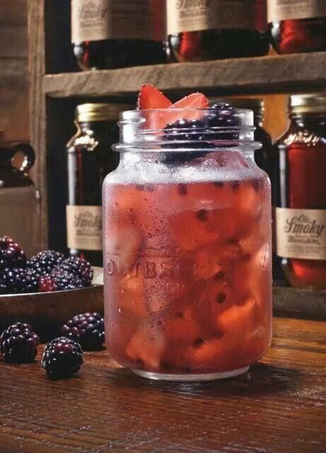The Ole Smoky Huckleberry Hooch | BlackBerry Moonshine with orange, pineapple, and cranberry juice.