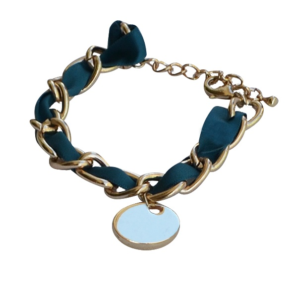 Vintage charm in petrol blue     Gold color faux chain bracelet , with petrol blue satin ribbon. There is a round charm hanging.