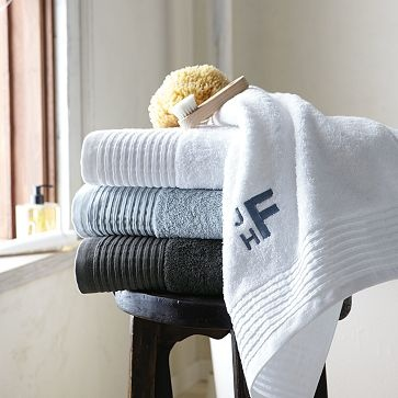 I am going to FINALLY spring for monogrammed towels...