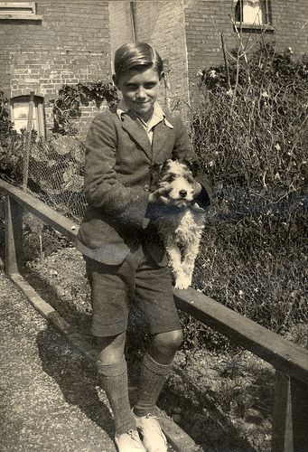 Boy with his dog in the garden