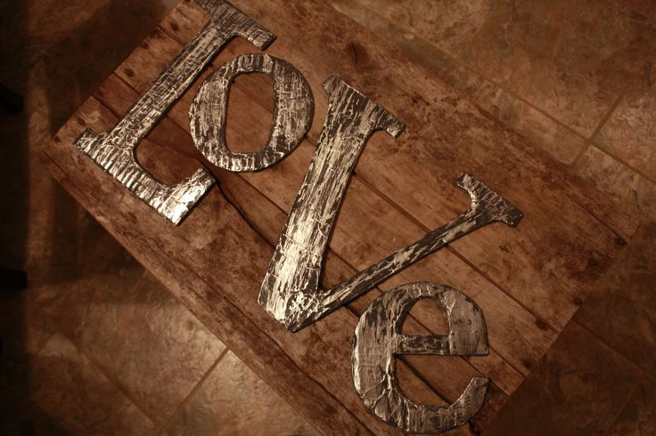 Distressed metal letters made of cardboard, foil & paint.