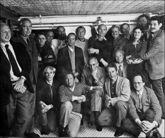Leo Castelli with Ellsworth Kelly, Dan Flavin, Joseph Kosuth, Richard Serra, Lawrence Weiner, Nassos Daphnis, Jasper Johns, Claes Oldenburg, Salvatore Scarpitta, Richard Artschwager, Mia Westerlund Roosen, Cletus Johnson, Keith Sonnier, Andy Warhol, Robert Rauschenberg, Edward Ruscha, James Rosenquist, Robert Barry.