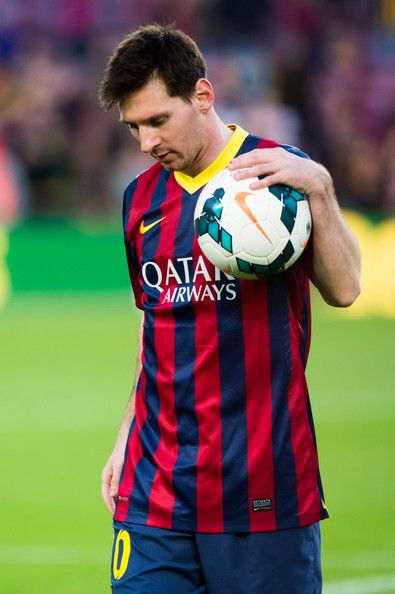 Lionel Messi with the ball of the match after scoring a hat-trick during the La Liga match between FC Barcelona and CA Osasuna at Camp Nou on March 16, 2014 in Barcelona, Catalonia.