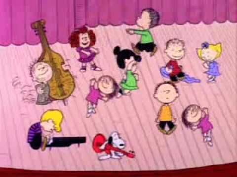 The Charlie brown theme song and how they all dance. and of course you have to love snoopy.