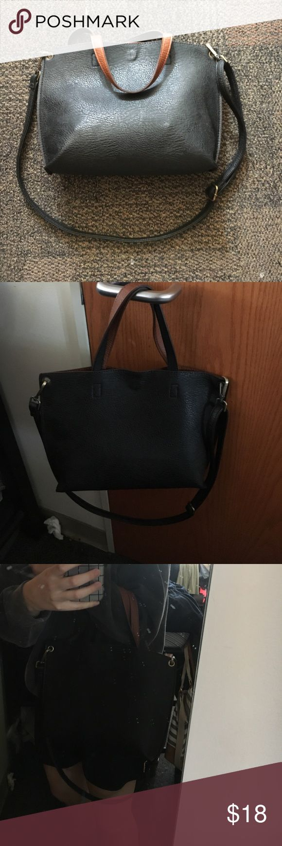 Black/tan reversible purse Black and Tan reversible mini tote bag. Great condition has a little removable wallet included. Cross body strap removable American Eagle Outfitters Bags Crossbody Bags