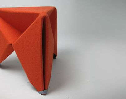 the felt folding stool brings origami and flat pack together in a piece of furniture