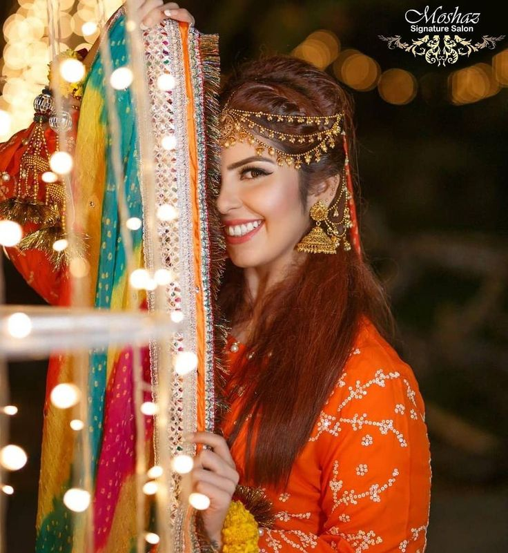Our mehndi bride looks stunning in our extremely elegant exquisitely crafted eye-catching  Our mehndi bride looks stunning in our extremely elegant ex...