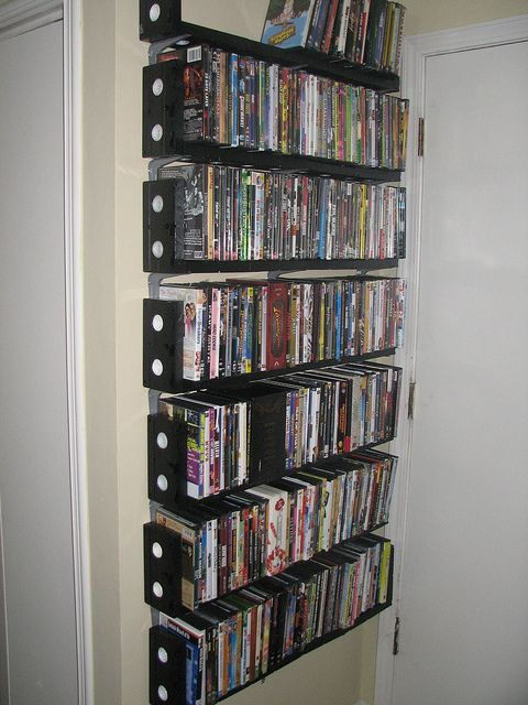"""DVD shelves made of VHS tapes! i feel like its a """"in your face old tech"""" but at the same time i like them"""