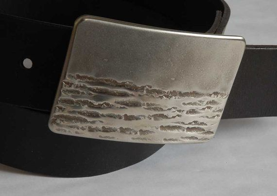 Silver Hand Forged Canadian Landscape Belt Buckle Artisan Signed Original Stainless Steel Hypoallergenic Fits 1.5 Leather Belt for Jeans  B u c k l e Hand Forged Buckle Signed by Artist, Robert Aucoin Buckle is Stainless Steel Hypoallergenic Canadian Landscape Design Belt shown with buckle in listing photo is black Oiled Buffalo Leather(sold separately $35)... perfect for blue jeans Buckle is Ultra Slim Line Design wont add bulk to your waistline Design on stainless steel created on the…